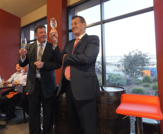 "Mark Littler and Jeff Kennett investigating the ""excellent leggings"" in the glass"